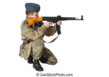 Soldier with submachine gun. Isolated on white background -...