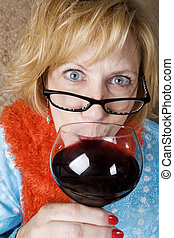 Crazy Woman Drinking Wine - Crazy woman with wild eyes...