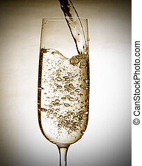 Sparkling wine - Close up of pouring sparkling wine