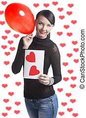 pretty brunette with valentine postcard and balloon