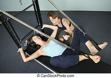 Woman Working Out With Personal Trainer - Athletic woman...