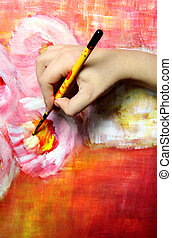 Artist paints his picture - Artists hand holding a...
