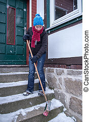 Snow on stairs - Woman sweep on stairs