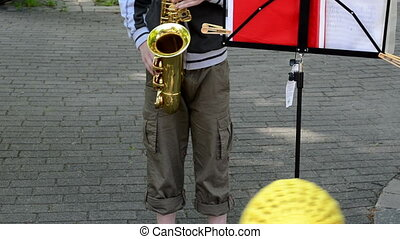 child play saxophone - VILNIUS, LITHUANIA - MAY 19:...
