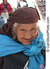 Beggar in Otavalo - An indigenous woman begging on the...
