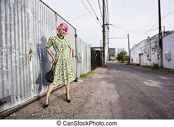 Woman with Pink Hair and a Purse in an Alley - Woman with...