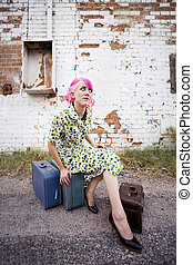 Woman with Pink Hair and a Small Suitcases - Woman with pink...