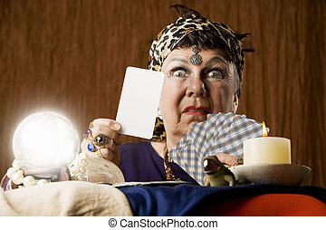 Gypsy with blank tarot card - Gypsy fortune teller with...