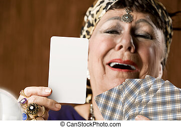 Gypsy with blank tarot card - Gypsy fortune teller hiolding...
