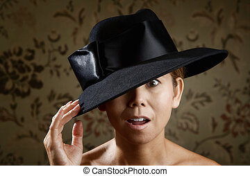 Ethnic woman in a black hat