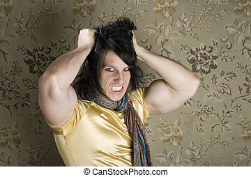 Frustrated Muscular Young Man Pulling Out His Black hair