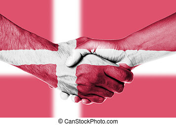 Man and woman shaking hands, wrapped in flag pattern,...