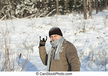 Man with a snowball in the hands