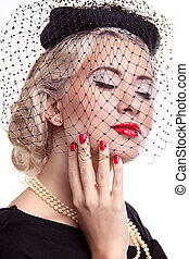 Blond Woman with bright make up and red nails in hat over...