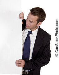 businessman standing with white board on an isolated white...
