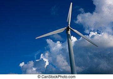 Wind turbine against blue sky.
