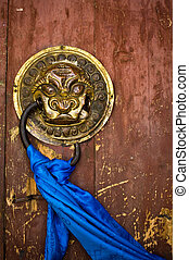 Door handle on ancient temple - Ornate door handle and...
