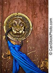Door handle on ancient temple - Ornate door handle and...