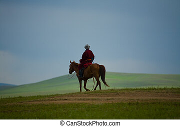 Mongolian nomad on a horse - A lone Mongolian nomad rides...