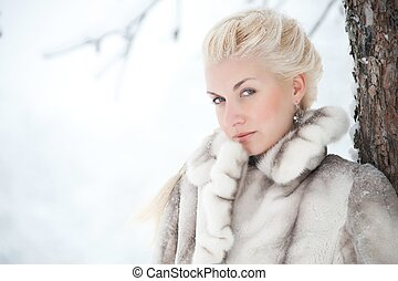 Attractive blond woman in fur coat.