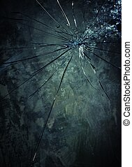 Broken glass over grey background.