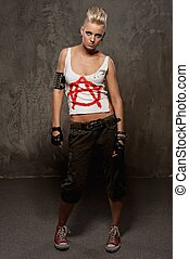 Punk girl against grey background