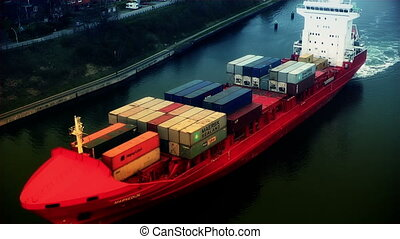 Cargo ship filled with containers passing