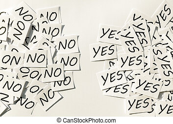 Yes and No - Yess and Nos written on papers on white...