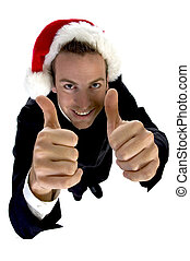businessman cheering with santa cap against white background