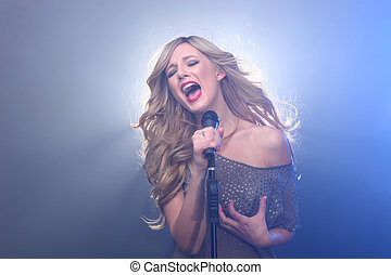 Beautiful Blonde Rock Star on Stage Singing - Blonde Rock...