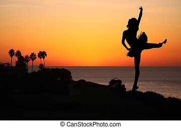 Ballet Dancer at Sunset Outdoors - Silhouette of a Ballet...
