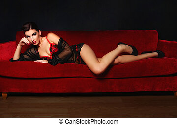 Beautiful Sexy Woman on a Couch - Studio Photo of a Sexy...