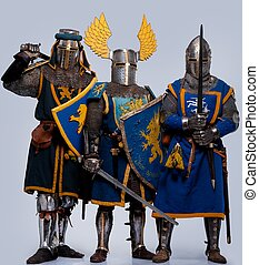 Three medieval knights isolated on grey background
