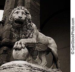 Stone lion statue at piazza della Signoria in Florence