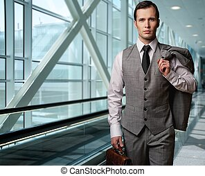 Man with a briefcase in an airport.