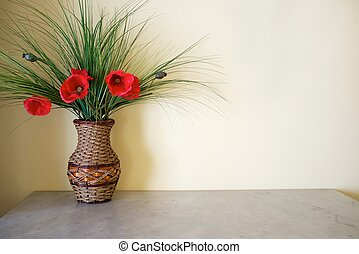 Vase with flowers on table.