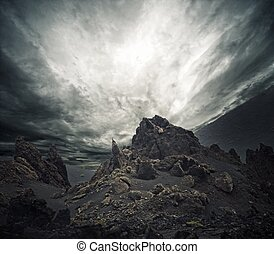 Dramatic sky over rocks