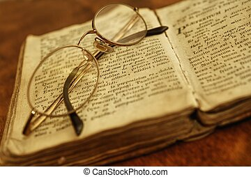 Glasses on vintage book