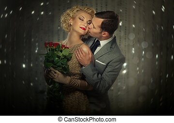 Happy couple with red roses