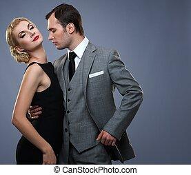Retro couple isolated on grey background