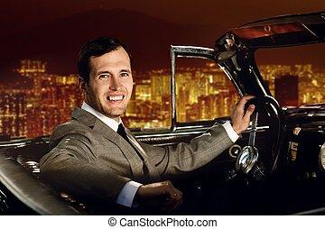Man driving retro car against