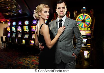 Retro couple against slot machines