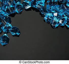 Many blue gems on black