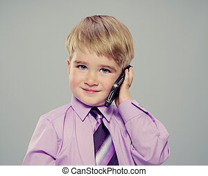 Baby boy in a purple shirt with a cell phone