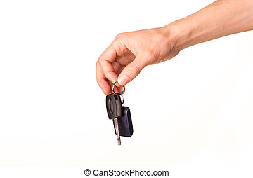 Male hand holding a car key isolated on white. New car...