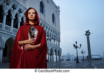 Beautiful woman in red cloak against Dodges Palace