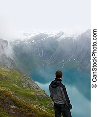 Man hiker in scandinavian landscape