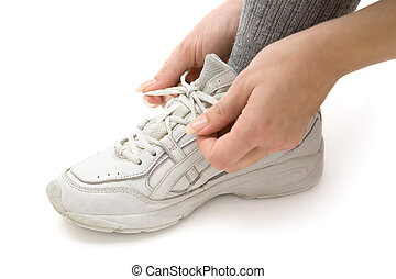 Tying Running Shoe - Woman tying her running shoes White...