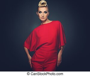 Fashionable woman in red with creative hairstyle