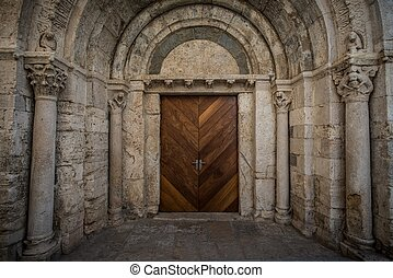 Wooden door in ancient archway